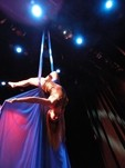 FLYING HIGH:  Gigi Penton of Suspended Motion Aerial Arts soars over the crowd during a performance. - PHOTO COURTESY OF SUSPENDED MOTION