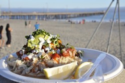 HANGER CURE:  A fish taco piled high with all kinds of good stuff is synonymous with the Avila Beach Farmers' Market. - PHOTO BY CAMILLIA LANHAM
