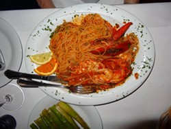 GLOBE-TROTTING FOR FOODIES :  Trattoria Gargani's spaghetti with spicy garlic marinara and lobster and grilled veal chop with arugula and tomatoes was one of the highs amongst a surprisingly varied tour of Europe. - PHOTOS BY DAN HARDESTY