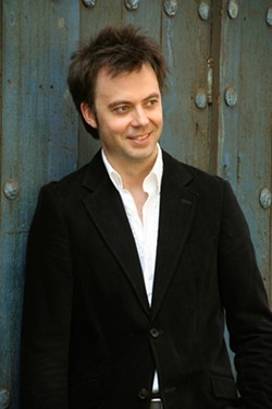 """MAGIC FINGERS! :  """"Rudolf: No Limits"""" comes to the Clark Center on Oct. 25 when SLO piano virtuoso Rudolf Budginas takes the talented SLO Youth Symphony on a fast-paced journey from Bach to Brazil. - PHOTO COURTESY OF RUDOLF BUDGINAS"""
