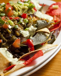 CHIP ON YOUR PLATE :  The vegetarian nachos—like all this establishment's nacho plates—are made with the chips fried to order. - PHOTO BY STEVE E. MILLER