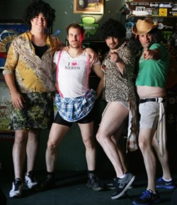 DUDES LOOK LIKE LADIES … NOT REALLY :  (Left to right) Zoe Baysinger, Cody Polakowski, Joss Mississippi, and Cody Hartwell strutted their stuff on April 7 at Frog and Peach, with tips going to autism research. - PHOTO BY GLEN STARKEY
