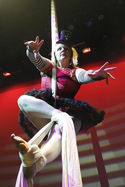 WANNA HANG OUT?:  Liz Stevenson channels her best creepy circus performer in Carnival of Phobias, happening Oct. 23 and 24 in Suspended Motion. - PHOTO COURTESY OF SUSPENDED MOTION