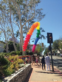 SOMEWHERE OVER ...:  Folks flocked to Sunday's Pride in the Plaza to grab food, LGBTQ-themed souveniers, and to see several great performances on the main stage, including Alex Newell from Glee. - PHOTO BY MAEVA CONSIDINE