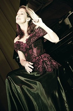 THE DELTA LADY ON PIANO: - PHOTO COURTESY OF AXIS ARTIST MANAGEMENT
