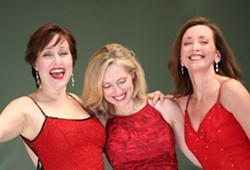 RED AS SANTA:   Karen Culliver, Mary D'Arcy, and Teri Bibb put on a show that embodies the holly, jolly spirit of the season. - PHOTO COURTESY OF THE PHANTOM'S LEADING LADIES