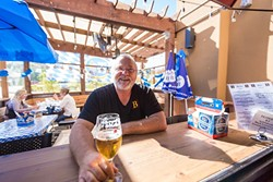 THE BIER MAN :  Beda Schmidthues and his wife, Helga, are pouring their heart, soul, and delicious family recipes into the hearty offerings at Beda's Biergarten. - PHOTO BY KAORI FUNAHASHI