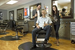 HAIRCUT HEAVEN :  Owner Brian Osgood (center) decided to open a place where guys can get a good haircut and a beer. This summer enter to win at Clippers and you might get free haircuts for life under the trimmers of stylists Blake Straight and Kristen Charbonneau. - PHOTO BY STEVE E. MILLER