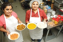 STARS OF INDIA :  Neelie Jaggi (left) and Deepika Jaggi offer savory midday meals for delivery to customers on a budget who savor fare faithful to Mumbai tradition. - PHOTO BY STEVE E. MILLER