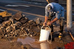 EXODUS COMES TO SLO?:  A Monterey Street water main break on Sept. 21 (above) and a hazardous material removal at the downtown Bath and Body Works on Sept. 23 (below) might have had SLO residents feeling like plagued Egyptians of yore. However, there were natural explanations for both incidents, and both dangers were resolved. - PHOTO BY STEVE E. MILLER