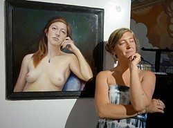 DUTCH BEAUTY:  Paige Kromhout struggles to keep from cracking up in front of her portrait. - PHOTO BY GLEN STARKEY