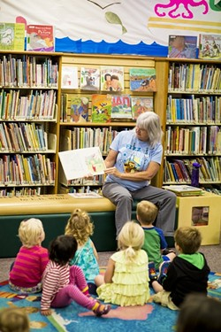 TALES FOR TOTS:  Summertime reading is a good way to prevent kids from forgetting what they learned during the school year. - PHOTO BY HENRY BRUINGTON