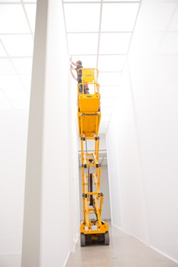 Jeff Jamieson works on Robert Irwin's installation piece Double Blind at Secession in Vienna, Austria. - PHOTO BY DEBORAH DENKER