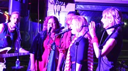 OOH-OOH, AH-AH:  Risky Whippet regulars Connor Parsons (far left) and Wendelin Van Draanen (far right) encouraged the Whippettes of Dec. 13 (center left to right: Teri Bayus, Ryan Miller, and Wendy Thies Sell) to sound more like singers and less like monkeys as they ah-ah-ahed their way through a Who holiday number. - PHOTO BY VAL PILLOW
