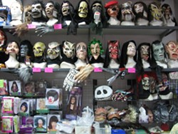 TRICK OR TREAT! :  Just in time for Halloween, Costume Capers new location offers an even bigger assortment of costume supplies than before. - PHOTO BY PATRICK R. BARBIERI