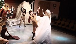 WOULD YOU LIKE SOME TURKISH DELIGHT? :  Edmund Pevensie (Spencer Doyle) gets duped by the White Witch (a role shard by Alison Maddren and Mackenzie Allen) in ACT's The Lion, The Witch, and the Wardrobe, directed by Shelagh Garren. - PHOTO COURTESY OF THE ACADEMY OF CREATIVE THEATER