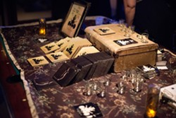 MERCH BOOTH:  Not only did the band have both their albums for sale, but they were also hawking stickers and shot glasses. - PHOTO BY STEVE E. MILLER