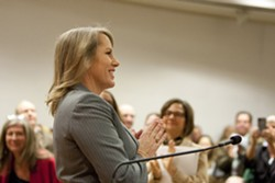 A MUCH-ANTICIPATED APPOINTMENT:  Caren Ray thanked a crowded room of supporters for the standing ovation after she was sworn to her new seat as SLO County 4th District supervisor on Oct. 8. - PHOTO BY STEVE E. MILLER