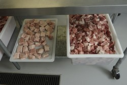 4: :  The tray on the left is pancetta for the Buona Tavola restaurants and the tray on the right is shoulder and leg meat that will be used in the salami production.