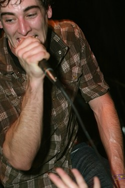 SING IT LIKE YOU MEAN IT! :  PK'S Travis Hawley rips into one of his band's new songs during their album release party at Downtown Brew - PHOTO BY GLEN STARKEY