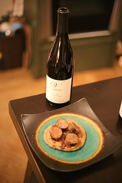 COURSE THREE :  Apple sausage over homemade flatbread with caramelized onions and stone ground mustard goes great with the silver medaled 2008 Pinot Noir. - PHOTO BY GLEN STARKEY