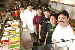 OUT-OF-THIS-WORLD FOOD :  Part of the Pluto's team stand ready to serve. Pictured are (back to front) Josie Jespersen, Stacy Benson, Dana Pearson, Melissa Sullivan, Karen Diep, and Preston King. - PHOTO BY STEVE E. MILLER