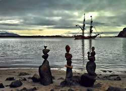 ROCK THE PLANK:  When pirate ships came to Morro Bay, Clarke rushed to balance some nearby rocks before the ships vanished. - PHOTO COURTESY OF KATHY CLARKE