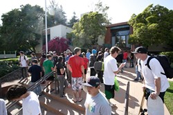 FIGHT FOR THE RIGHT TO OLLIE:  Skaters swarmed SLO City Hall on May 20 and were rewarded for their civic activism with a City Council pledge to pay to design a bigger and better skate park at Santa Rosa Park. - PHOTO BY STEVE E. MILLER