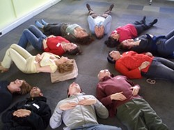 IN STITCHES :  Typical Laughter Yoga classes are so merry, participants exhaust themselves giggling. - PHOTO COURTESY BOB BANNER