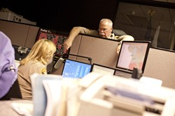 DOWN TIME :  Chief Deputy John Giese served as the watch commander on a recent Friday night, when he assisted dispatchers like Kelly Fontes. - PHOTO BY STEVE E. MILLER