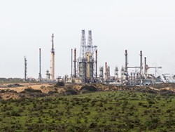 SOMETHING BREWING:  Though a proposal to transport oil by rail to the Phillips 66 Santa Maria Refinery in Nipomo (pictured) is still under - evaluation, some recently filed lawsuits against Phillips 66 could portend a legally thorny future for the project. - FILE PHOTO BY KAORI FUNAHASHI