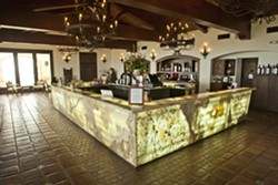 GLOWING STONE :  The Daou Vineyards tasting room has a backlit stone bar with room for at least 40 people to try different wines. - PHOTO BY STEVE E. MILLER