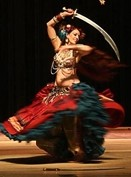 SWORDS AND SWIRLS :  Seba displays the vibrancy of costume and motion. - PHOTO COURTESY OF WENDY OLIVER