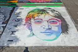 DOUBLE FANTASY:  The street painting festival attracts varied and vibrant works of art like last year's entry from Cannon Corp., a stunning, rainbow John Lennon. - PHOTO BY JOSEF KASPEROVICH