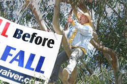 """KID IN A TREE :  Resident Joey Racano, the self-styled """"Los Osos Kid,� threw a shit fit when the project flushed several of his furry friends off the lot at Tri-W. He staged a month-long protest leading up to the September recall."""