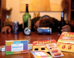 PILL POPPER :  Intrepid reporter Glen Starkey drank for the greater good and tested two brands of hangover pills. Did they work? Read on! - PHOTO BY JENNIFER MAY ANTHONY