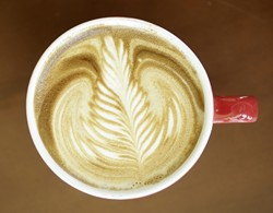 LATTE ART :  Jonathan Withers of Joe Momma's Coffee poured this leaf.