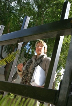 GATED COMMUNITY :  Good fences make good neighbors, and also keep transients from sitting here, in front of the Broad Street bathrooms across from Big Sky CafÈ. Betsy Kiser (pictured), facilitator for the Transient Task Force, says this is one of the group's most remarkable success stories. - PHOTOS BY CHRISTOPHER GARDNER