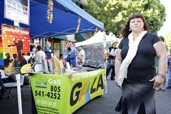 WEEKLY EVENT :  Shannon Wyndsong staffs the Gay and Lesbian Alliance booth at San Luis Obispo's Farmers' Market each week. She believes that the booth is a great educational opportunity, letting people know about the local lesbian, gay, bisexual, and transgender community beyond the Pride events.