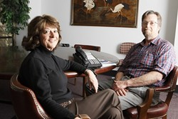 READY TO LISTEN:  211 SLO Hotline executive director Linda McGregor (left) and program director Mike Bossenberry (right) provide helpful ears for troubled local callers. - PHOTO BY STEVE E. MILLER