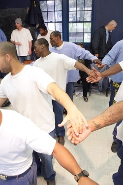 LIGHT OF FOOT :  Inmate performers rehearse an Elizabethan dance the day before opening night. - PHOTO BY STEVE E. MILLER