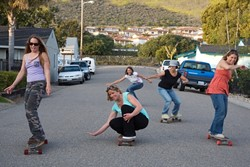 ROLLIN WITH THE SISTERS :  Surf Sisters (left to right) Jennifer Jozwiak, Deby Hansen (crouching), Christy Serpa (background), Colleen Gnos, and Jennifer Blonder want to show you movies for the good of the ocean. - PHOTO BY JESSE ACOSTA