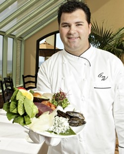 ON THE CLIFFS :  Chef Gregg Wangard creates delicious dishes at Marisol at the Cliffs Resort. He's pictured here with Manila clams, Spanish chorizo, big-eye tuna, sunflower sprouts, Meyer lemon, Fuji apple, and more. - PHOTO BY STEVE E. MILLER