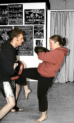ALL'S FAIR IN LOVE AND KICKBOXING :  My boyfriend Peter and I often work out together and hold protective pads for each other during our Muay Thai classes at the Budo-Ryu School of Martial Arts in San Luis Obispo. The proper technique for landing a knee punch is using momentum from your hips to push the knee out, rather than bringing it straight up, at your opponent. - PHOTO BY ERIC SANDAHL