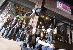 GREAT SKATE! :  Co-owners Jono and Stephanie Hicks (foreground) recently opened Coalition, a skate shop in San Luis Obispo. Behind them are (left to right) Jessica, Neil, John (in the window), Sophie, Danielle, Tyler, Joel, Erica, and John. Oh, and Ken in the air. - PHOTO BY STEVE E. MILLER