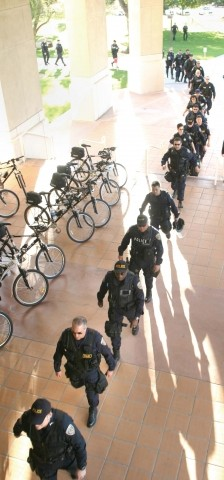 "IN STEP :  On Friday afternoon, hundreds of officers met at Cal Poly for a pre-Mardi Gras briefing by SLOPD chief Deb Linden. After Linden's warm remarks, (""Be friendly,� she said, ""[but] arrest the people that need arresting.�) the officers reviewed crowd-control tactics. - CHRISTOPHER GARDNER"