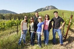 POLY WINES :  The Cal Poly Wine Festival is on its way. Pictured right to left are Sara Steffens, event coordinator Meredith Soden, winery coordinator Erica Bergvall, silent auction/sponsorship coordinator Emily Reneau Steven Larsen, web designer and Ryan Crosbie, Vines to Wines president. - PHOTO BY STEVE E. MILLER