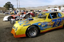 JUMP IN THE PIT:  The pit at the Santa Maria Speedway sits in the middle of the oval track. Before each heat and race, cars are tuned, wiped clean, and tinkered with until they are ready for the next event. - PHIL KLEIN