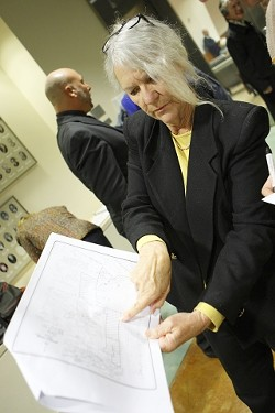 KEEP 'EM OUT :  Nell Langford, an off-highway-vehicle opponent and member of Safe Beach Now, believes the Oceano Dunes would be safer if cleared of all motorized vehicles. She's pictured here preparing to speak about a different dunes issue--proposed bathrooms--before the SLO County Board of Supervisors meeting on Jan. 15. - PHOTO BY STEVE E. MILLER