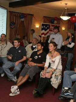 SHOCK AND AWE :  While Republicans at parties around the county were celebrating, Democrats — like these gathered at Peg Pinard's election night bash — quietly watched as several of their favorite candidates lost. - CHRISTOPHER GARDNER